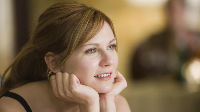 "FILE - This 2006 publicity photo released by Columbia Pictures shows actress Kirsten Dunst as Mary Jane Watson in a scene from ""Spider-Man 3."" (AP Photo/Columbia Pictures, Merie W. Wallace, File)"