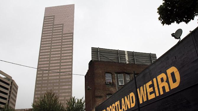 A downtown building sports a popular slogan in relation to the city in Portland, Ore., Wednesday, Sept. 19, 2012. Researchers at Portland State University found that the Portland atmosphere and culture is a magnet for the young and college educated, even though a disproportionate share of them are working in part-time jobs or positions that don't require a college degree. (AP Photo/Don Ryan)