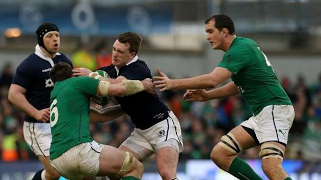 Scotland's Stuart Hogg, pictured taking on Ireland's Peter O'Mahony (left) and Devin Toner during Sunday's match in Dublin, should stay at full-back according to his Glasgow coach Gregor Townsend