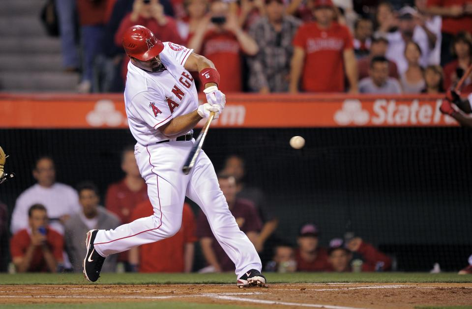 Los Angeles Angels' Albert Pujols hits into a double play during the first inning of baseball game against the Kansas City Royals, Friday, April 6, 2012, in Anaheim, Calif. (AP Photo/Mark J. Terrill)