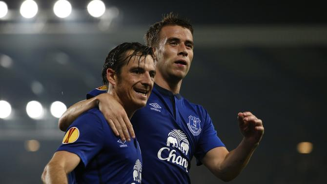 Everton's Coleman celebrates after scoring the second goal with teammate Baines during their Europa League soccer match against VfL Wolfsburg at Goodison Park