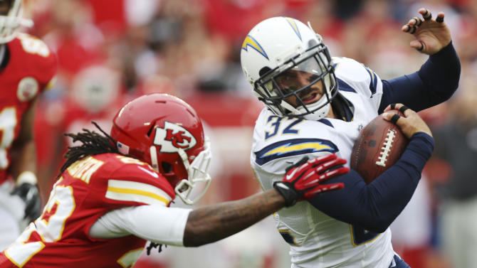 San Diego Chargers free safety Eric Weddle (32) gets past Kansas City Chiefs wide receiver Dexter McCluster (22) after an interception during the first half of an NFL football game at Arrowhead Stadium in Kansas City, Mo., Sunday, Sept. 30, 2012. (AP Photo/Ed Zurga)