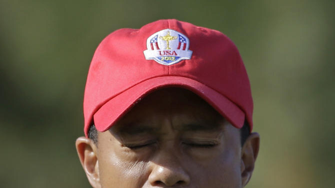 USA's Tiger Woods reacts after making a long birdie putt on the 11th hole during a four-ball match at the Ryder Cup PGA golf tournament Friday, Sept. 28, 2012, at the Medinah Country Club in Medinah, Ill. (AP Photo/Chris Carlson)