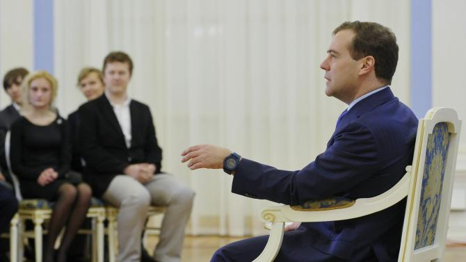 Russian Prime Minister Dmitry Medvedev, right, speaks during his meeting with Russian pupils in the Gorki residence outside Moscow, Russia, on Friday, Nov. 2, 2012. Medvedev said Friday that he detested the Pussy Riot act, but added the women have been in prison long enough and should be released. (AP Photo/RIA-Novosti, Alexander Astafyev,  Government Press Service)