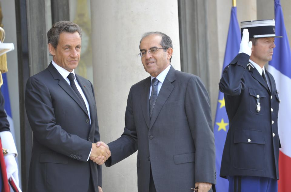 France's President Nicolas Sarkozy, left, greets the head of Libya's opposition government  Mahmoud Jibril  at the Elysee Palace in Paris.  Wednesday, Aug. 24, 2011. (AP Photo/Jacques Brinon)