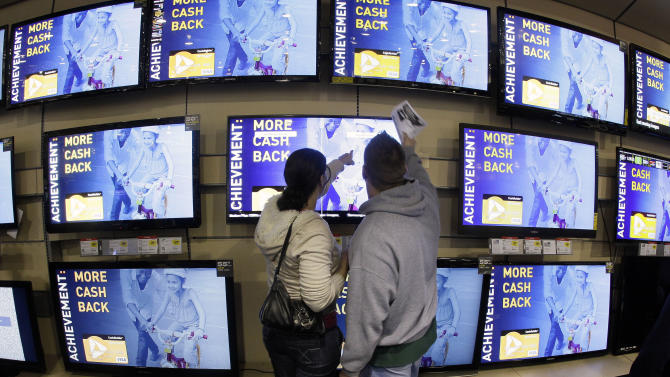 Shoppers look at televisions displayed at a Best Buy store after a midnight opening on Friday, Nov. 25, 2011, in Brentwood, Tenn. Black Friday began in earnest as stores opened their doors at midnight. (AP Photo/Mark Humphrey)