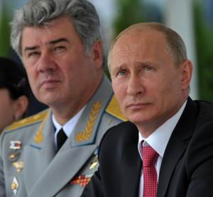 Russian President Vladimir Putin, right, and Commander-in-Chief of the Russian Air Force Viktor Bondarev watch as they attend the Russian air force's 100th anniversary in Zhukovsky, outside Moscow, Russia, on Saturday, Aug. 11, 2012. (AP Photo/RIA-Novosti,  Alexei Nikolsky, Presidential Press Service)