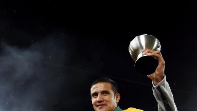 Australia's Tim Cahill poses with his trophy after they beat South Korea to win the Asian Cup at the Stadium Australia in Sydney
