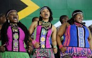 "South African dancers perform at a Social Cohesion Summit in Kliptown, Soweto. Archbishop Desmond Tutu coined the term in 1994 to celebrate post-apartheid South Africa but 18 years on, the ""rainbow nation"" is battling entrenched racial, social and economic divisions"