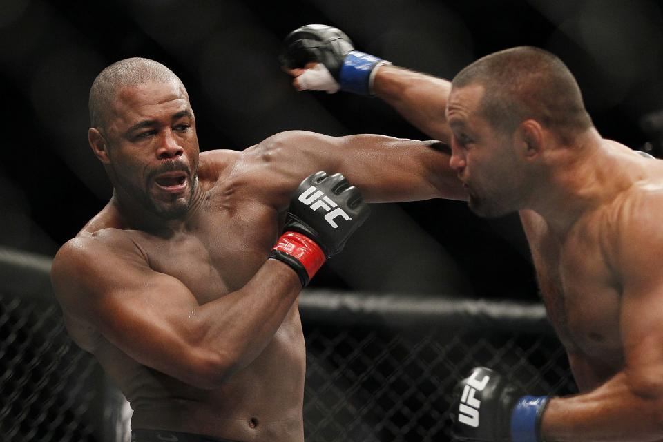 Rashad Evans,left, and Dan Henderson battle during UFC 161 in Winnipeg, Manitoba on Saturday June 15, 2013.  (AP Photo/The Canadian Press, John Woods)