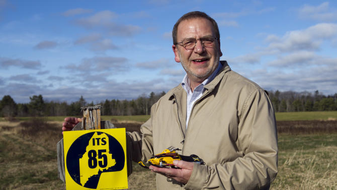 In this photo made Thursday, Nov. 15, 2012, Bob Myers, executive director of the Maine Snowmobile Association, stands next to a sign marking interstate snowmobile trail 85 in Augusta, Maine. FirstWind and other wind power companies in Maine are working with snowmobilers' groups to make their sites destinations for winter sledders via 600 miles of trails that are mostly there already. (AP Photo/Robert F. Bukaty)