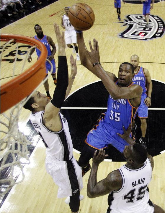 Oklahoma City Thunder small forward Kevin Durant (35) shoots over San Antonio Spurs guard Danny Green (4) and forward DeJuan Blair (45) during the first half of Game 5 in the NBA basketball Western Co