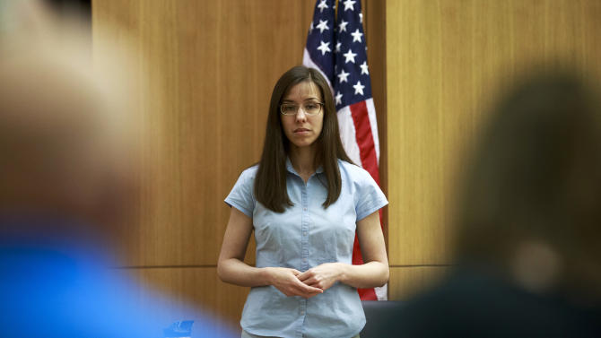 Defendant Jodi Arias takes the stand before testifying during her murder trial in Superior Court Tuesday, Feb. 5, 2013, in Phoenix.   Arias is accused of murdering her lover, Travis Alexander at his Mesa, Ariz., home in 2008.  (AP Photo/The Arizona Republic,  Charlie Leight)       MARICOPA COUNTY OUT  NO SALES