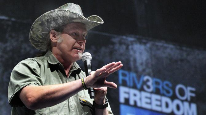 """FILE - In this May 1, 2011, file photo, musician and gun rights advocate Ted Nugent addresses a seminar at the National Rifle Association's 140th convention in Pittsburgh. Nugent said he was insulted by the cancellation of his planned concert at an Army post over his comments about President Barack Obama. Commanders at the Fort Knox, Ky., post nixed Nugent's segment of a June concert after the rocker and conservative activist said at a recent National Rifle Association meeting that he would be """"dead or in jail by this time next year"""" if Obama is re-elected. (AP Photo/Gene J. Puskar, File)"""