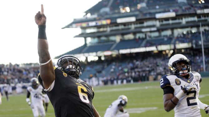 Arizona State running back Cameron Marshall (6) celebrates his a 33-yard touchdown run near Navy cornerback Parrish Gaines (2) during the second half of the Fight Hunger Bowl NCAA college football game in San Francisco, Saturday, Dec. 29, 2012. (AP Photo/Marcio Jose Sanchez)