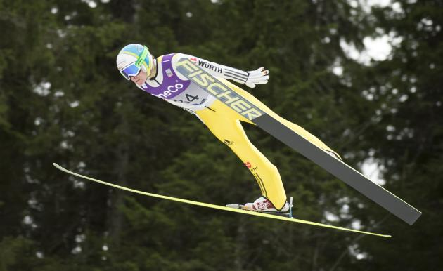 Riessle of Germany soars through the air during the WC Nordic combined competition in Trondheim