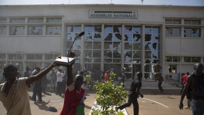 Anti-government protesters loot the parliament building in Ouagadougou