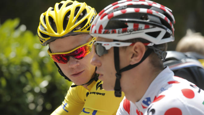 Christopher Froome of Britain, wearing the overall leader's yellow jersey, and Pierre Rolland of France, wearing the best climber's dotted jersey, ride during the thirteenth stage of the Tour de France cycling race over 173 kilometers (108.1 miles) with start in in Tours and finish in Saint-Amand-Montrond, western France, Friday July 12 2013. (AP Photo/Christophe Ena)