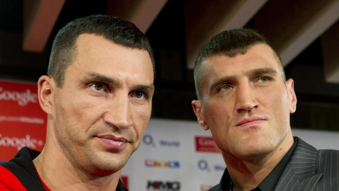 WBA, IBF and WBO heavyweight world champion Wladimir Klitschko, left, from Ukraine, poses with his Polish challenger Mariusz Wach in Hamburg, Germany, Monday, Nov. 5, 2012. The title bout between Klitschko and Wach is scheduled for upcoming Saturday, Nov. 10, 2012. (AP Photo/dapd, Joerg Sarbach)