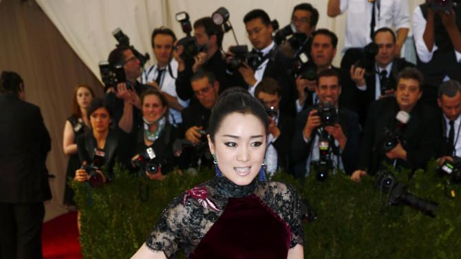 """Chinese actress Gong Li arrives at the Metropolitan Museum of Art Costume Institute Gala 2015 celebrating the opening of """"China: Through the Looking Glass"""" in Manhattan"""