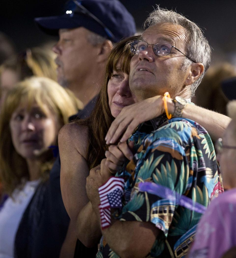 Mourners watch as 19 purple balloons are released during a candlelight vigil in Prescott, Ariz. on Tuesday, July 2, 2013 to honor the 19 Granite Mountain Hotshot firefighters who were killed by an out-of-control blaze near Yarnell, Ariz. on Sunday. (AP Photo/Julie Jacobson)