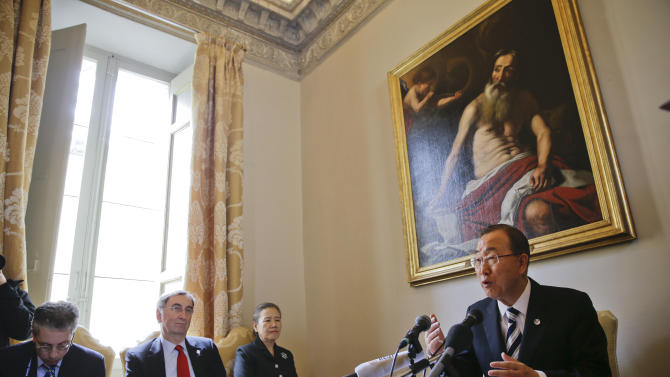 U.N. Secretary-General Ban Ki-moon, right, talks to the media during a press conference, at the Vatican, Tuesday, April 28, 2015. Ban Ki-moon, who earlier in the morning met Pope Francis during a private audience, opened a Vatican conference on the environment that is a key part of the Holy See's rollout of Francis' eagerly awaited encyclical — a pope's most authoritative teaching document — which is expected in June.(AP Photo/Andrew Medichini)
