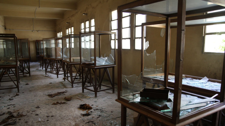 Rows of display cases are broken and empty at the Malawi Antiquities Museum after it was ransacked and looted between the evening of Thursday, Aug. 15 and the morning of Friday, Aug. 16, 2013 in Malawi, south of Minya, Egypt, Saturday, Aug. 17, 2013. The interim Cabinet authorized police to use deadly force against anyone targeting police and state institutions on Thursday. The violence capped off a week that saw more than 700 people killed across the country. (AP Photo/Roger Anis, El Shorouk Newspaper) EGYPT OUT