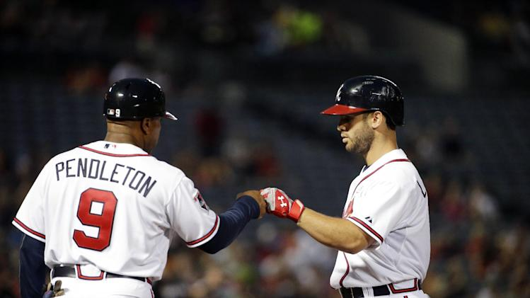 Atlanta Braves' Tommy La Stella, right, fist-bumps first base coach Terry Pendleton after hitting a single in the second inning of a baseball game against the Miami Marlins, Friday, Aug. 29, 2014, in Atlanta. (AP Photo/David Goldman)