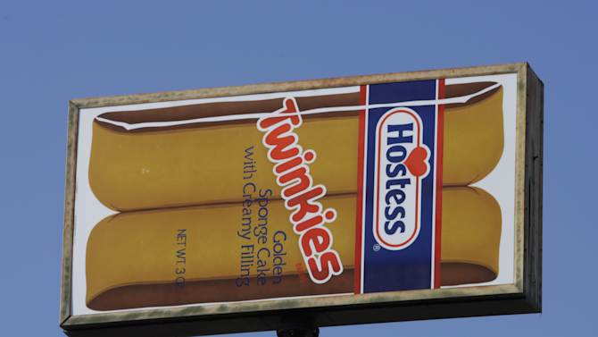 FILE - A Hostess Twinkies sign is shown at the Utah Hostess plant in Ogden, Utah, in this Nov. 15, 2012 file photo.  Hostess Brands Inc. says it's in talks with more than 100 parties interested in buying its brands, which include Twinkies, Ding Dongs and Ho Hos. (AP Photo/Rick Bowmer, File)