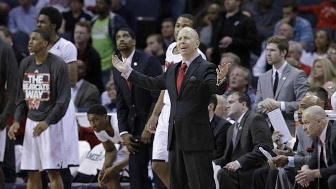 Cincinnati coach Mick Cronin reacts to a call that went against his team during the second half of an NCAA college basketball game against Connecticut in the semifinals of the American Athletic Conference men's tournament Friday, March 14, 2014, in Memphis, Tenn. Connecticut won 58-56
