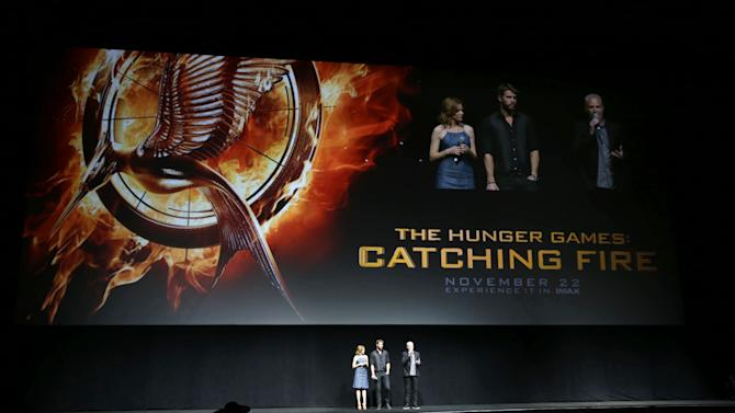 "Elizabeth Banks and Liam Hemsworth, cast members in the upcoming film ""The Hunger Games: Catching Fire""  and Francis Lawrence, director of the upcoming film ""the Hunger Games: Catching Fire"" at Lionsgate Presentation at 2013 CinemaCon, on Thursday, April, 18th, 2013 in Las Vegas. (Photo by Eric Charbonneau/Invision for Lionsgate/AP Images)"