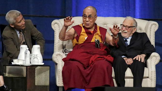 The Dalai Lama (C), seated with oceanographer Walter Munk (2nd L) and Congresswoman Loretta Sanchez (not pictured), speaks at the University of California, Irvine