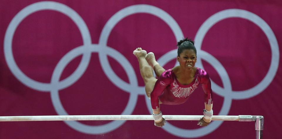 U.S. gymnast Gabrielle Douglas performs on the uneven bars during the artistic gymnastics women's individual all-around competition final at the 2012 Summer Olympics, Thursday, Aug. 2, 2012, in London. (AP Photo/Matt Dunham)