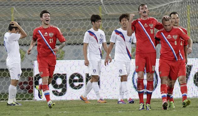 Russia's midfielder Dmitry Tarasov, third right, celebrates with his teammates scoring a goal against South Korea during the international friendly soccer match between Russia and South Korea, in Duba