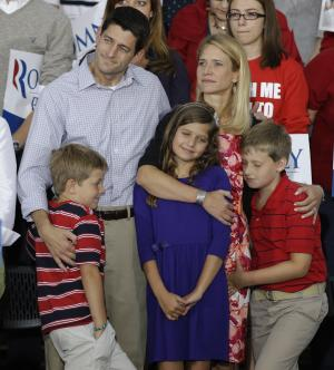 Vice presidential running mate Rep. Paul Ryan, R-Wis,left,  his wife Janna and daughter Liza and sons Charles, and Sam, right, during a welcome home rally Sunday, August, 12, 2012 in Waukesha, Wis. (AP Photo/Jeffrey Phelps)