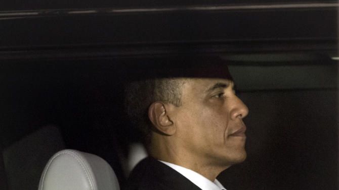 President Barack Obama is seen through the window of a limo as he returns to the White House for the first time since his victory on election day, in Washington, Wednesday, Nov. 7, 2012. (AP Photo/J. Scott Applewhite)