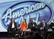 From left to right, Steven Tyler, Jennifer Lopez, Randy Jackson and Ryan Seacrest participate in the American Idol panel at the Fox Broadcasting Company Television Critics Association Winter Press Tour in Pasadena , Calif. on Sunday, Jan. 8, 2012. (AP Photo/Danny Moloshok)