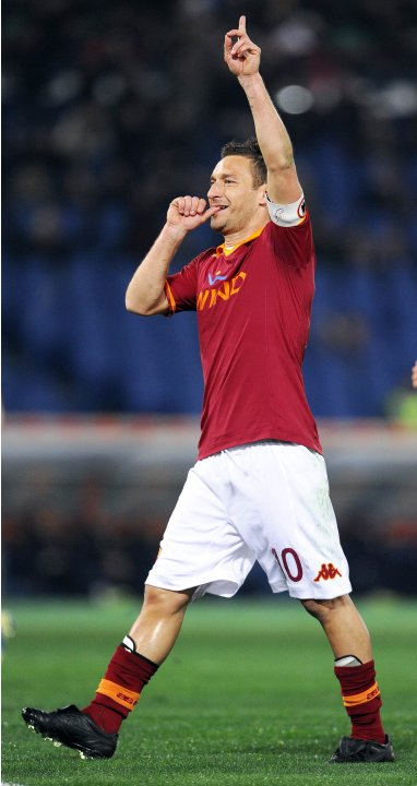 AS Roma's Francesco Totti celebrates after scoring against Genoa in their Serie A soccer match at Olympic stadium in Rome