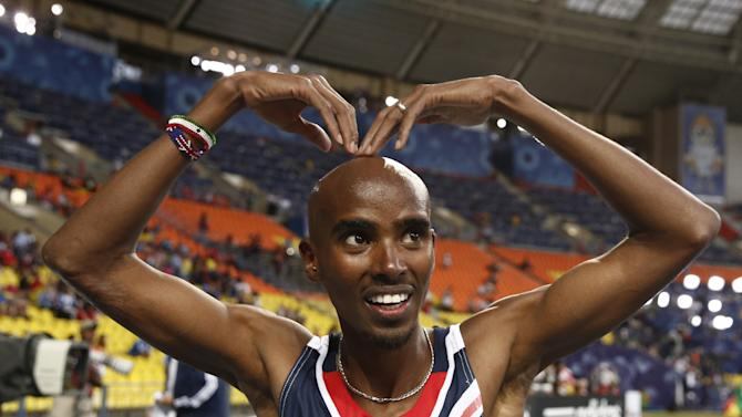 Great Britain's Mo Farah celebrates after winning the men's 5000 metres final at the world championships in Moscow, on August 16, 2013