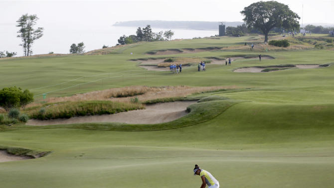 Mariajo Uribe of Colombia putts on the first green during the first round at the U.S. Women's Open golf tournament at Sebonack Golf Club in Southampton, N.Y., Thursday, June 27, 2013. (AP Photo/Seth Wenig)