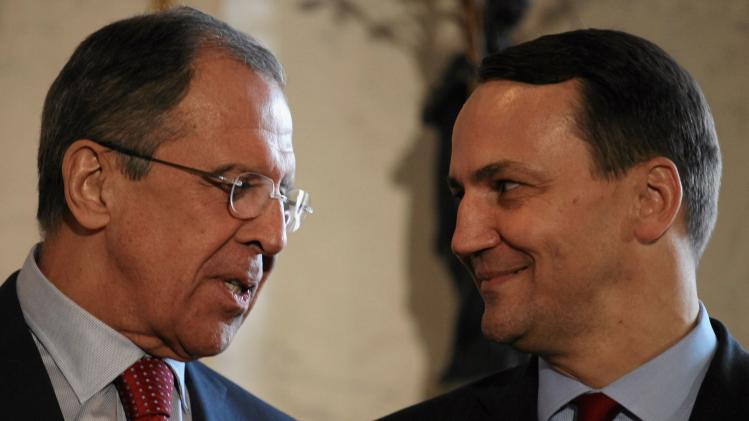 Poland's FM Sikorski and Russian FM Lavrov after talks in Warsaw