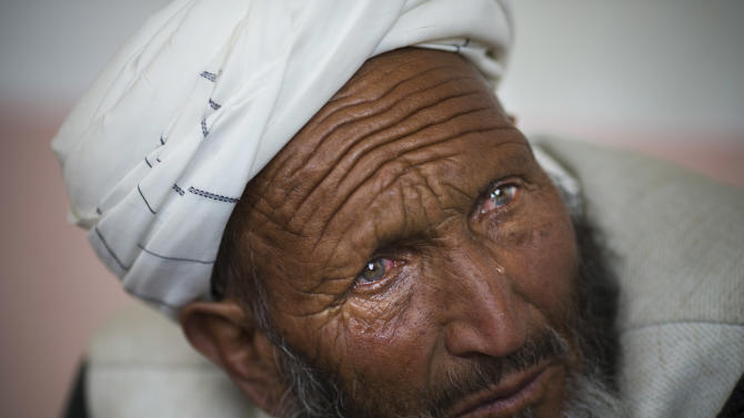 Mohammed Isaq, weeps as he tells the story of his nephew's arrest by U.S Special Forces in Maidan Shahr, Wardak province, Afghanistan, Sunday, March 10, 2013. Afghan President Hamid Karzai, infuriated by villager reports of forced detentions and mass arrests, gave U.S. Special Forces two weeks to vacate Wardak province, located barely 30 kilometers (24 miles) from the Afghan capital of Kabul. The deadline for their withdrawal expired midnight Sunday, March 10, 2013. (AP Photo/Anja Niedringhaus)