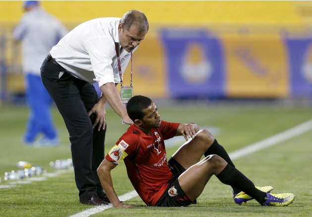 Al-Rayyan's head coach Aguirre talks to Hamid Ismail during their Qatar Stars League soccer match against  Al-Gharafa in Doha