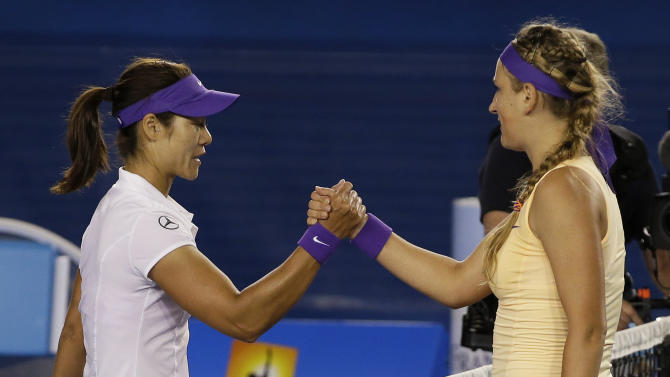 Victoria Azarenka, right, of Belarus is congratulated by China's Li Na after winning the women's final at the Australian Open tennis championship in Melbourne, Australia, Saturday, Jan. 26, 2013.  (AP Photo/Andy Wong)