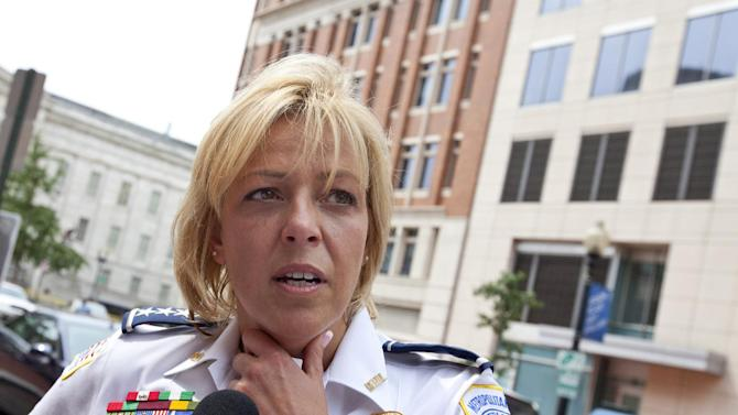 FILE - This Aug. 15, 2012 file photo shows Washington Police Chief Cathy Lanier meeting with reporters in Washington. Washington's murder rate was approaching nearly 500 slayings a year in the early 1990s, the annual rate has gradually declined to the point that the city is now on the verge of a once-unthinkable milestone. The number of 2012 killings in the District of Columbia stands at 78 and is on pace to finish lower than 100 for the first time since 1963, police records show.  (AP Photo/J. Scott Applewhite, File)
