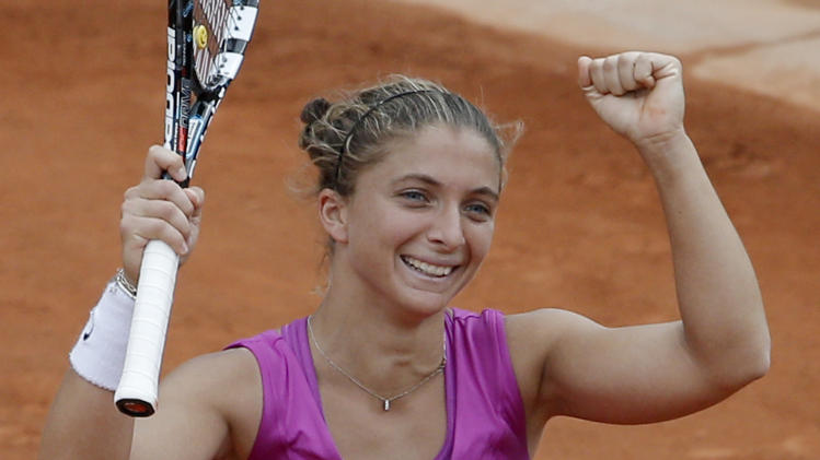 Sara Errani of Italy celebrates winning her semi final match against Samantha Stosur of Australia at the French Open tennis tournament in Roland Garros stadium in Paris, Thursday June 7, 2012. Errani won in three sets 7-6, 1-6, 6-3. (AP Photo/Christophe Ena)