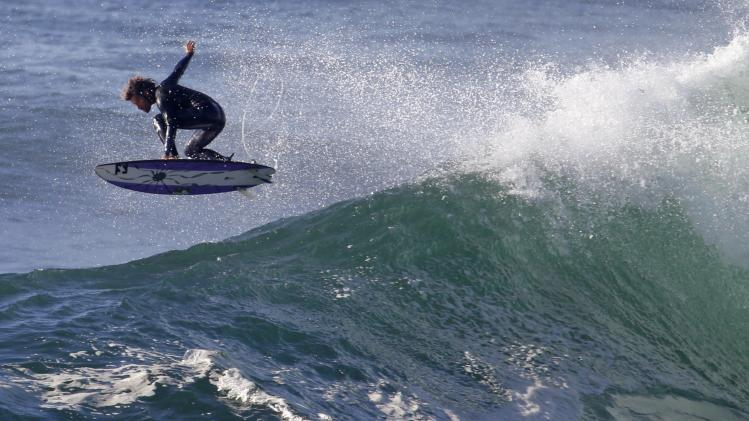 Dave Rastovich competes in the Red Bull Cape Fear invitational surfing tournament off the shores of southern Sydney