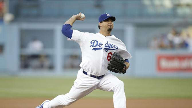 Los Angeles Dodgers starting pitcher Josh Beckett throws against the Pittsburgh Pirates during the first inning of a baseball game on Friday, May 30, 2014, in Los Angeles. (AP Photo/Jae C. Hong)