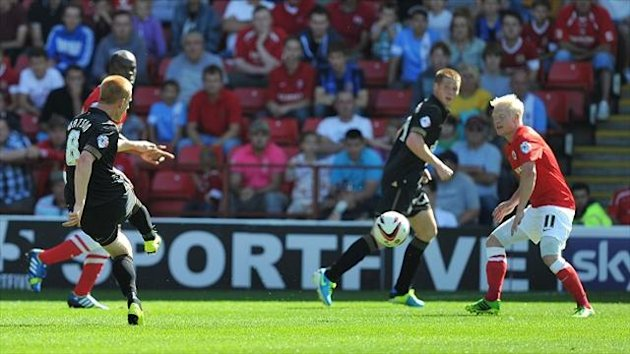 Ben Watson, left, scored the first of Wigan's four goals