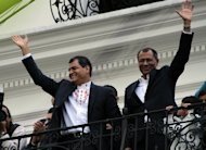 Ecuadorian President Rafael Correa (L) celebrates his re-election with VP-elect Jorge Glass in Quito on February 17, 2013. Correa declared victory in the first-round of Ecuador&#39;s presidential vote as he celebrated with thousands of supporters in the country&#39;s capital